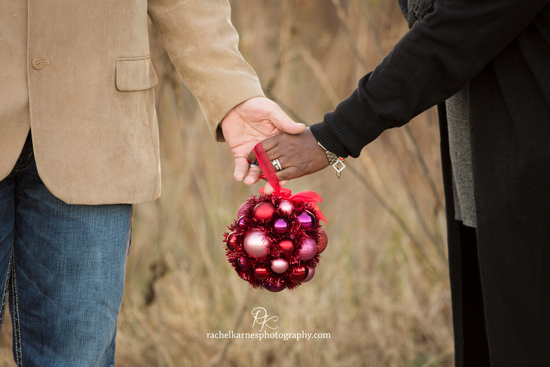 Couple holding mistletoe