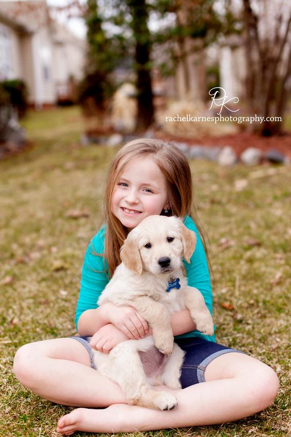 Little girl in yard with goldie puppy in creekside landing VA