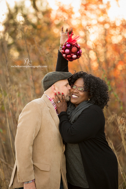 Williamsburg couple kissing under mistletoe