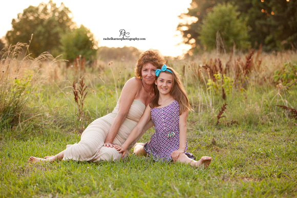 Mother and daughter sunset field photo