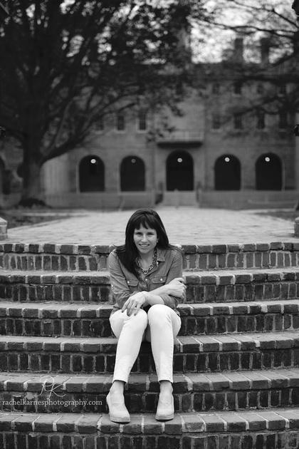 Senior portrait on sunken garden steps in front of Wren Building in Williamsburg VA