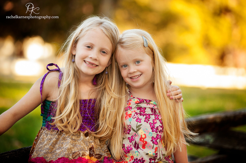 Siblings in colonial williamsburg gardens during spring family photo session