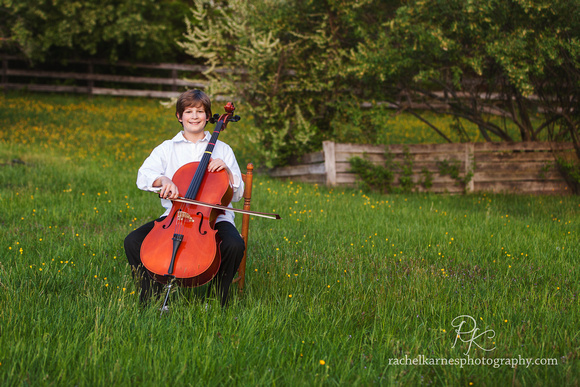 Boy playing cello in Virginia field