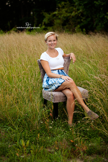 High School Senior in field on chair photo