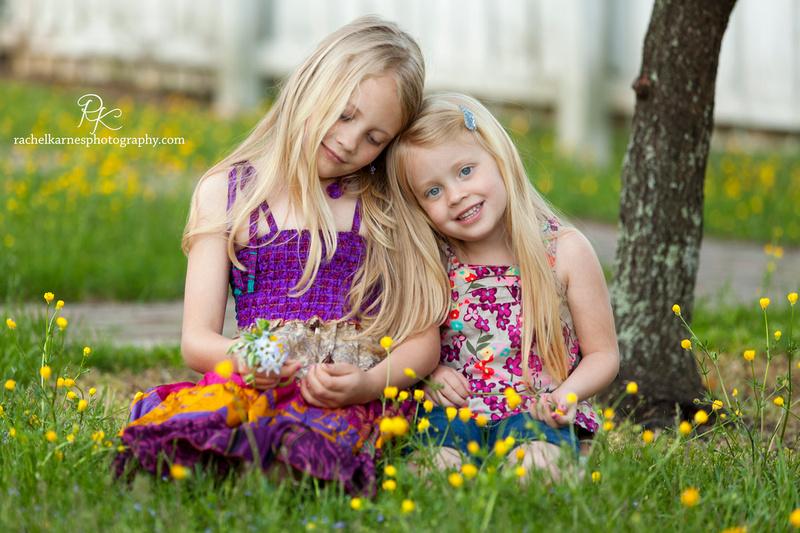 Sibling girls in field of flowers in Williamsburg