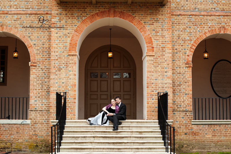 formal couple on steps of wren building in williamsburg
