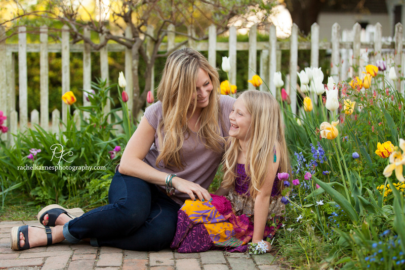 mother and daughter laughing in colonial williamsburg garden