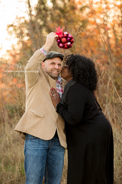 Couple with mistletoe in Williamsburg field