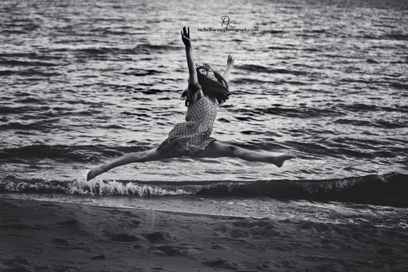 girl leaping on Williamsburg beach