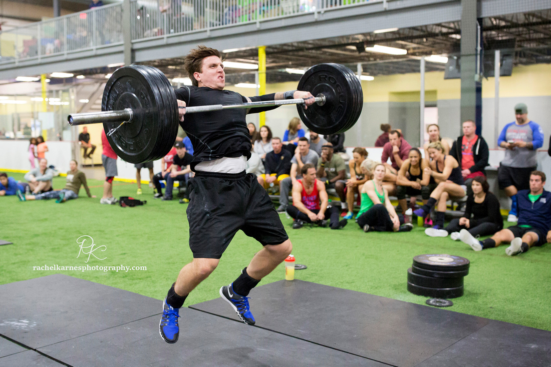 male-athlete-snatching-at-crossfit-competition