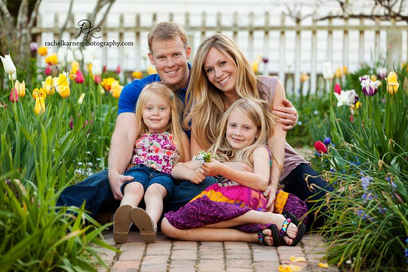 Happy family sitting in tulips in Virginia
