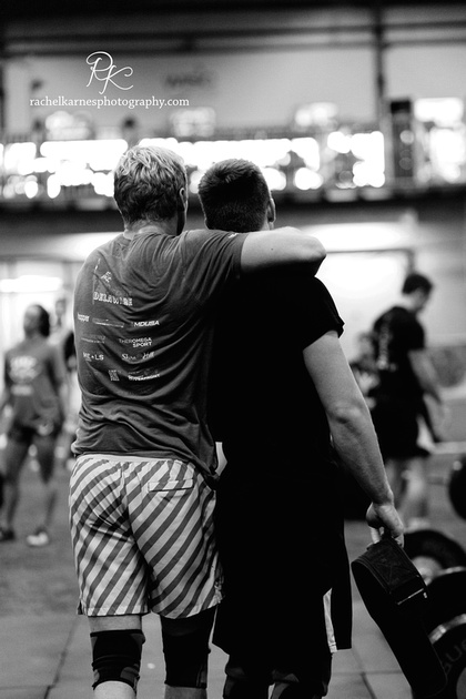 male-teammates-hug-at-williamsburg-competition