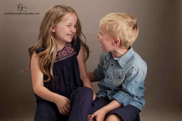 Siblings-laughing-in-Williamsburg-studio-photo-session